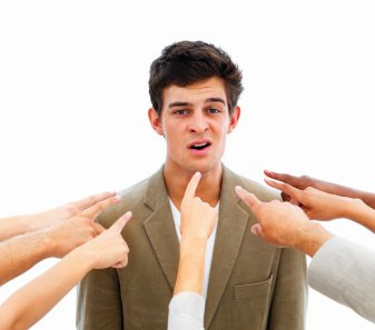 Closeup of human hands pointing towards business man